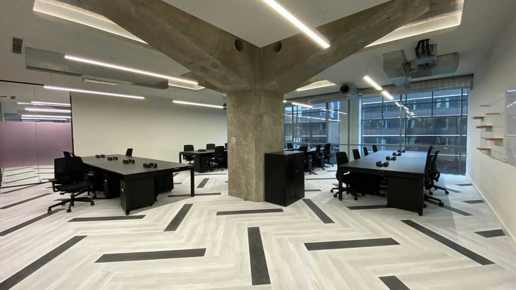 The building's concrete structure is allowed to dominate this desking area.